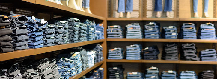 store shelves with stacks of jeans
